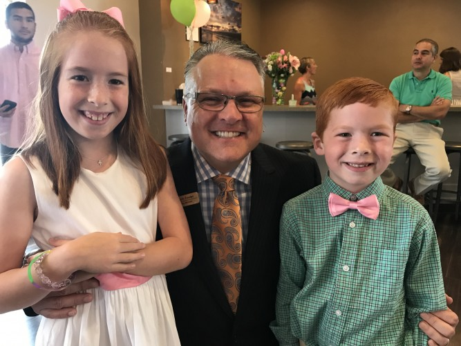 Pastor Mark with two children