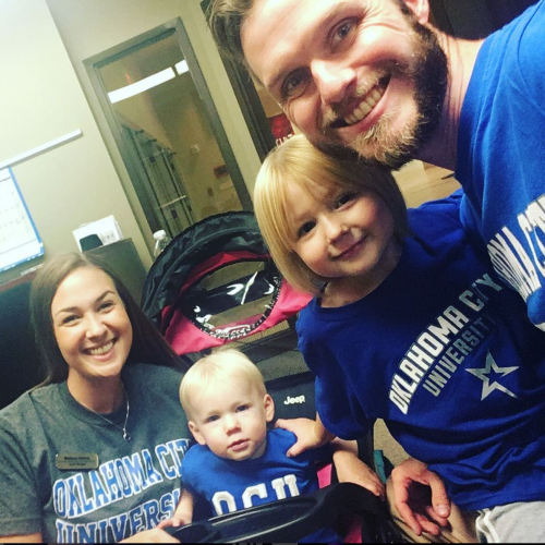 Andy and Melissa Nelms with their children at College Colors Night