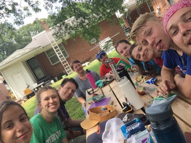 Youth sitting together at picnic table